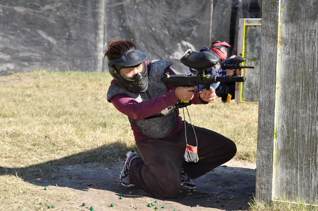 Girl playing paintball at Urban War Zone
