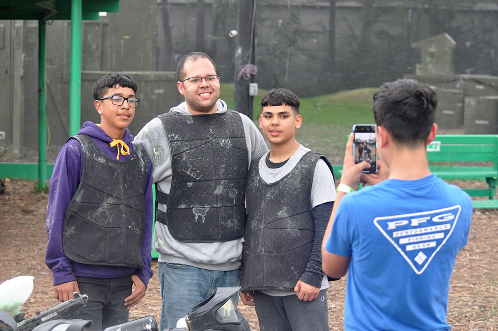 Playing paintball with family and friends